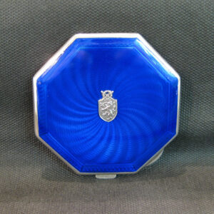 silver and deep blue guilloche enamel compact.