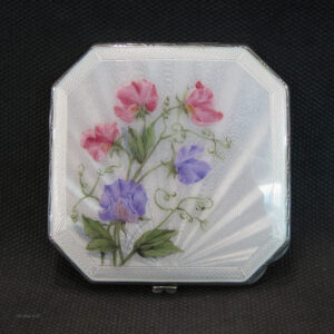 Silver compact with hand painted enamel .