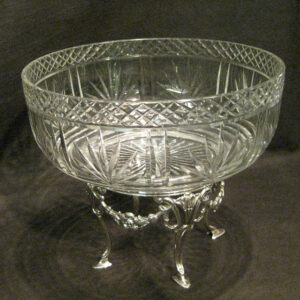 An antique silver based cut crystal fruit bowl.