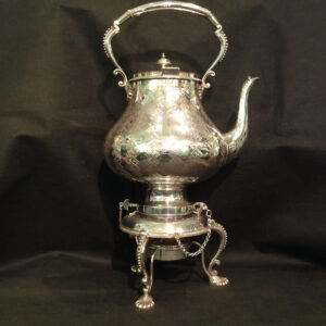 A silver plated Kettle on stand.