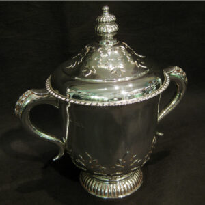 Antique arts and crafts silver cup with cover.