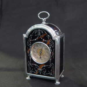 Pique tortoise shell carriage clock.