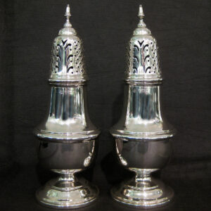 A pair of silver sugar castors.