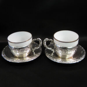A delicate pair of coffee cups mounted in silver.