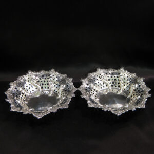 A pair of silver pierced and embossed bon bon dishes.