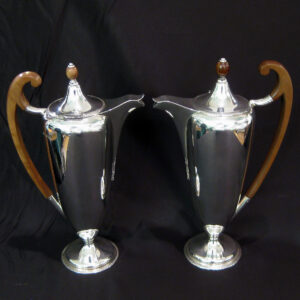 A pair of stylish silver pots/jugs.
