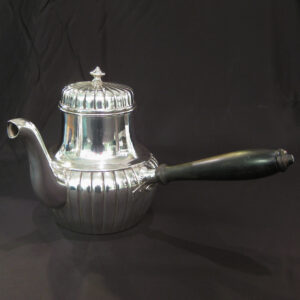 Side handled silver teapot.