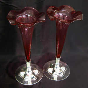 A pair of cranberry bud vases