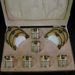 A Bone china/silver gilt coffee set