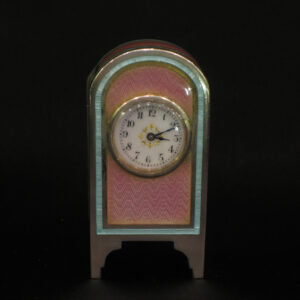 A miniature enamel and silver clock