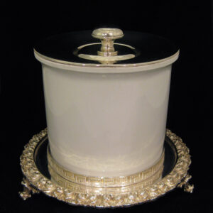 A biscuit box by Mappin and Webb.