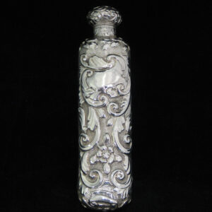 Highly decorative sterling silver perfume bottle.
