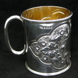 A fine quality silver embossed mug.