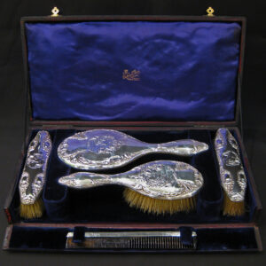 An art nouveau silver vanity set by Mitchell Bosley