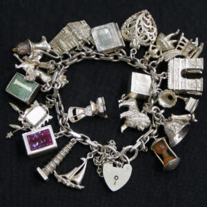 Silver charm bracelet with assorted charms.