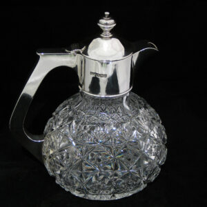 silver topped crystal claret jug by Walker & Hall.